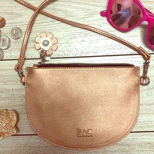Zac Posen NWOT. Rose gold cross body purse.